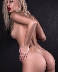Jessy, a natural model with fair hair, showing off her full figure and gorgeous face.